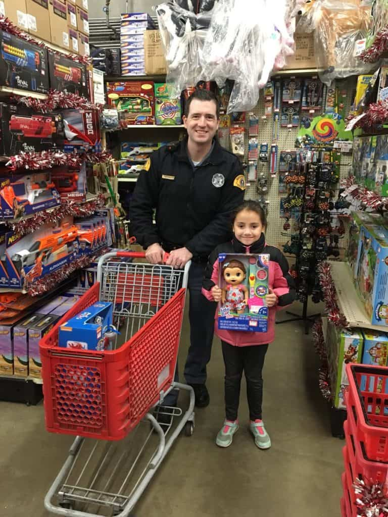 Young girl on shopping trip with Washington State Trooper in Shop with a Cop program